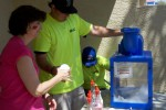 Mountain Vista Communities staff members Stephanie Martin (left) and Tyler Hardt served up free snow cones throughout the entire Mountain Vista Communities Summer Fun Bash, Saturday.