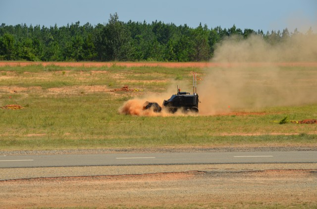 A specially designed, unmanned IED defeat vehicle traverses the Robotics Rodeo course