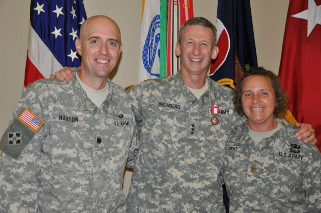 FORT BRAGG, N.C. -- Lt. Gen. Howard B. Bromberg stands one last time with his executive officer, Lt. Col. Timothy Norton, and his aide-de-camp, Maj. Jennifer Schulke, during his farewell ceremony as the FORSCOM deputy commanding general and chief of staff.