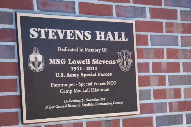 This plaque for Stevens Hall on Camp Mackall's Rowe Training Facility was formally dedicated during a ceremony May 10 held by the Soldiers of 1st Battalion, 1st Special Warfare Training Group (Airborne). The building hosts a professional development library, fitness center and sleeping quarters for special-operations training and support personnel. (U.S. Army photo by Dave Chace, SWCS Public Affairs Office)