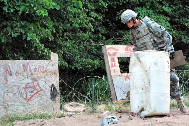Staff Sgt. Markus Whisman, Research, Development and Engineering Command, looks for unexploded ordnance during the STX lane events in the Army Materiel Command's Best Warrior Competition July 17 at Rock Island Arsenal, Ill.