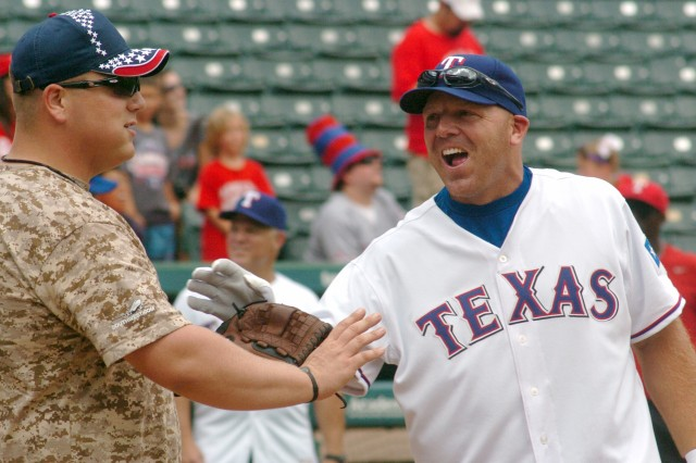 WTB catcher, Sgt. Mark Tsatsos, shares a laugh with Texas Ranger alum Kevin Mench, who played outfield for the Texas Rangers during the early 2000s. (Photo by Gloria Montgomery, WTB PAO)