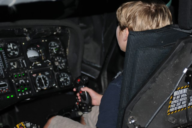 Adam Crider, a 9-year-old cancer patient from Gallatin, Tenn., flies the UH-60 Black Hawk flight simulator at Fort Campbell, Ky., July 17, 2012. Crider visited Fort Campbell after exchanging letters with Lt. Col. Scott Gerblick, the former commander of 7th Battalion, 101st Aviation Regiment, 159th Combat Aviation Brigade, during the unit's most recent deployment.
