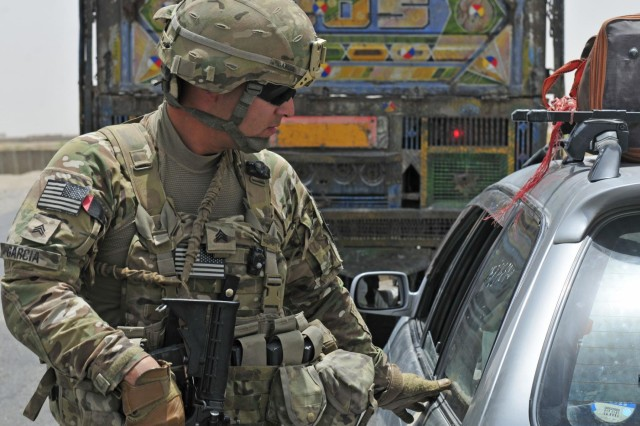 Sgt. Guillermo Garcia, an infantryman with Alpha Company, 1st Battalion, 17th Infantry Regiment, 2nd Infantry Division, works with Afghan Border Policemen at Checkpoint 9 along Highway 4 in the district of Spin Boldak, Afghanistan, July 5, 2012. Garcia is from Los Angeles, Calif.