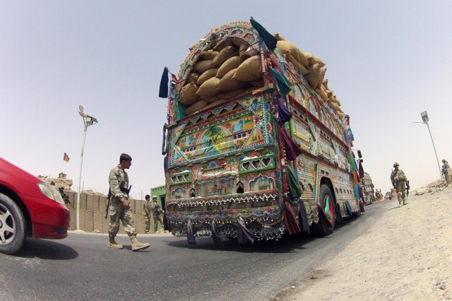 A member of the Afghan Border Police does a visual inspection of a jingle truck at Checkpoint 9 along Highway 4 in the district of Spin Boldak, Afghanistan, July 5, 2012. This Afghan Border Police checkpoint is one of the few that operates 24/7.