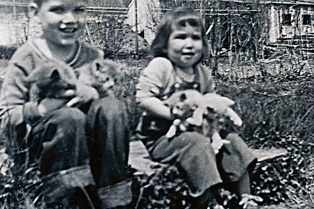 Rob McIlvaine sits with his sister, the future Pennsylvania legislator, Barb, holding a bunch of farm cats in front of the family dairy barn.