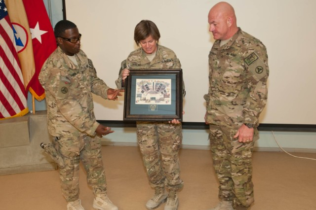 "Brig. Gen. Kristin K. French, the command general of the of the 3d Sustainment Command (Expeditionary) and Joint Sustainment Command "" Afghanistan, receives a plaque from Chief Warrant Officer Timothy Pippen and Chief Warrant Officer Curtis Grover, during the Warrant Officer Corps 94th Birthday celebration at Kandahar Airfield on July 9, 2012. French was the guest speaker at the event which honored the corps history and lineage. (U.S. Army photo by Staff Sgt. Michael Behlin)"