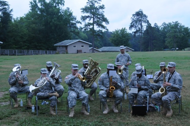 The 208th Army Band from Concord, N.C. plays for Military Day at Camp Hanes in King, N.C. on July 11. The week-long camp included a Military Day where children were exposed to different aspects of military life such as, camoflauge face paint, physical training and a static vehicle display. The children also wrote supportive letters to veterans and drew pictures that will become parts of a larger mural as a part of Project S.N.A.P. and the Operation Grateful Nation Mosaic Mural project.