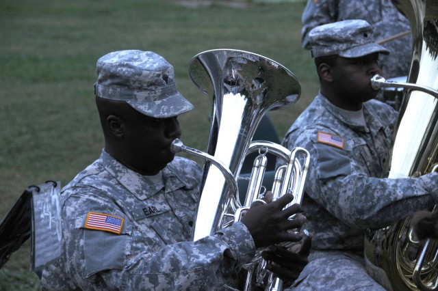 Specs. Curtis Earl and Sylvester Allen play their instruments at Camp Hanes in King N.C. on July 11. The week-long camp included a Military Day where children were exposed to different aspects of military life such as, camoflauge face paint, physical training and a static vehicle display. The children also wrote supportive letters to veterans and drew pictures that will become parts of a larger mural as a part of Project S.N.A.P. and the Operation Grateful Nation Mosaic Mural project. Earl plays the euphonium and Allen plays the tuba.