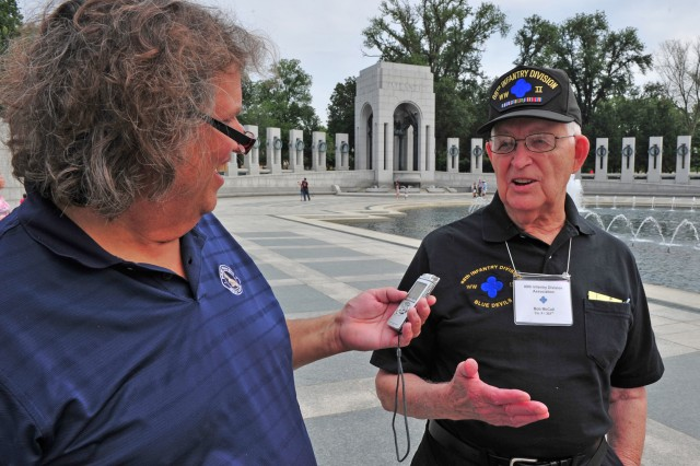 Rob McIlvaine interviews a WWII veteran at the World War II Memorial, Sept. 2, 2011, in Washington, D.C.