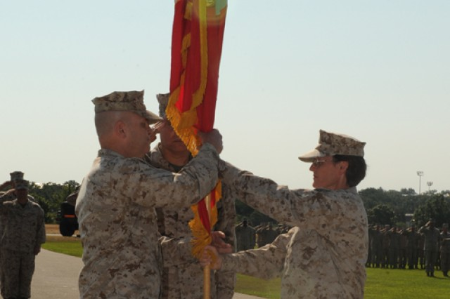 Col. John Giltz (left), incoming Marine Corps Det. commander, receives the unit colors from outgoing commander Col. Nancy Springer, officiated by Brig. Gen. John Simmons, Training Command commander, Friday.