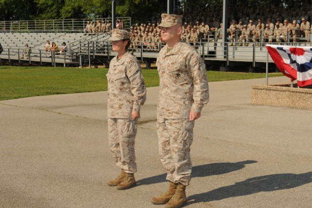 Col. Nancy Springer (left), outgoing commander for the Marine Corps Det. Fort Leonard Wood, and Col. John^Giltz, incoming commander, stand at attention during the change of command ceremony Friday.