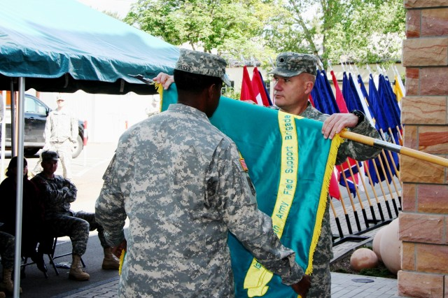 Lt. Col. Joe Gann, commander, 405th AFSBn Kaiserslautern and 405th Army Field Support Brigade Command Sergeant Major, Command Sgt. Maj. Jesse Sharpe case the battalion colors June 5 at the Daenner Kaserne, Kaiserslautern, Germany. (Photo by Steven J. Stanfill, 405th AFSB Public Affairs)