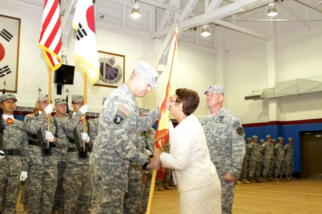 "Debra D. Zedalis (center) director, U.S. Army Installation Management Command Pacific Region, passes unit colors to Col. John M. Scott during a July 13 ceremony at Camp Red Cloud at which Scott assumed command of the U.S. Army Garrison Red Cloud and Area I. He replaced Col. Hank Dodge (right), who moves to Fort Bragg, N.C. "" U.S. Army photo by Sgt. First Class Jeff Troth"
