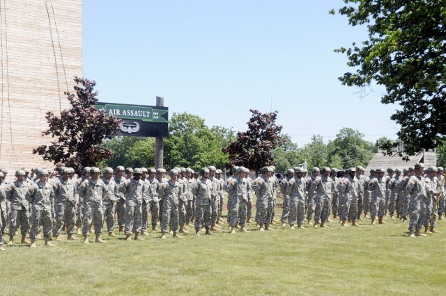 More than 100 Soldiers graduating from the Air Assault Course stand outside the Light Fighter School on June 29. Graduates were given their Air Assault Wings by their commanders, first sergeants and Family Members during the ceremony.