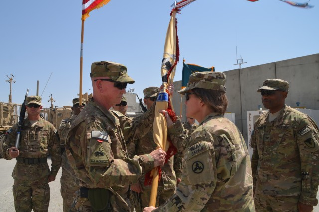 Col. Orlando Dale Critzer accepts the 401st Army Field Support Brigade colors from Brig. Gen. Kristin K. French, Joint Sustainment Command-Afghanistan commanding general during a change of command ceremony held at brigade headquarters Jul. 18.