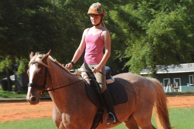 Dante, a strawberry roan Quarter Horse Belgian Cross, carries his rider Kiera Benehan, military Family member, through an exercise at the Fort Rucker riding stables July 16.