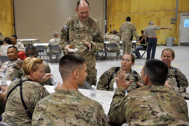Lt. Col. Garry Bush, outgoing commander of the 4th Battalion, 401st Army Field Support Brigade, talks with Soldiers at his farewell dinner at Kandahar Airfield, Afghanistan on July 13. More than 200 Soldiers and contractors attended the dinner to honor Bush and the accomplishments of the battalion under his command. (Photo by Sgt. Gregory Williams, 3rd SC(E) Public Affairs)