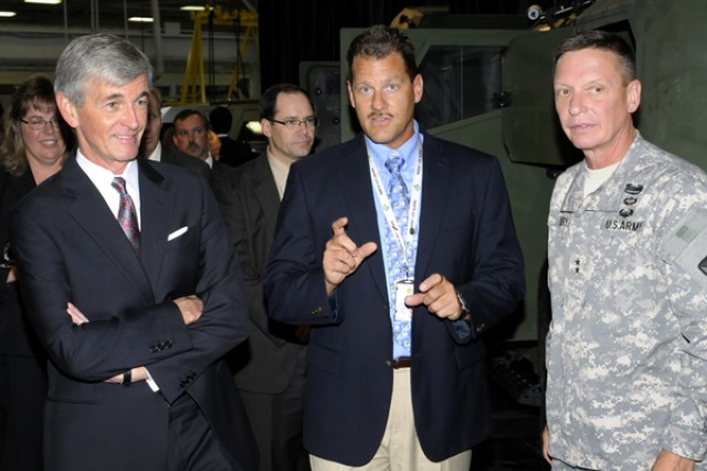 Steve Knott (center), TARDEC associate director of survivability, explains the work they are doing to Secretary of the Army John McHugh and TACOM LCMC Commanding General Maj. Gen. Michael J. Terry, during a visit to Detroit Arsenal in Warren, Mich., July 19, 2012..