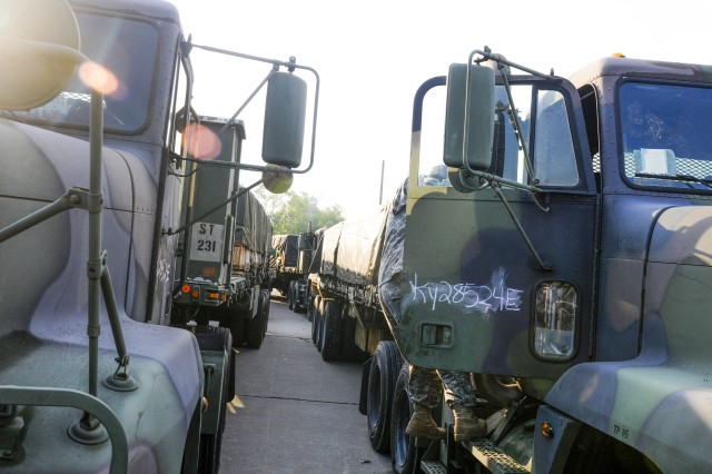 Soldiers from the 424th Transportation Company out of Galax, Va., prepare for convoy operations early Wednesday morning at Task Force Wildcat's headquarters at Blue Grass Army Depot, Ky., during Operation Golden Cargo. Golden Cargo 2012 is the 21st in a series of annual training operations sponsored by the Joint Munitions Command and executed by Reserve Component units.