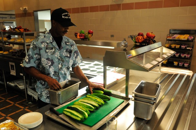 "SCHOFIELD BARRACKS, Hawaii "" Pvt. Keon Scott, a food service specialist with 225 Brigade Support Battalion, 2nd Brigade Combat Team, prepares cucumbers for a dish that will be served at lunch. The Soldiers of the Warrior Inn DFAC are setting the bar high with their recent Phillip A. Connelly award for the best DFAC in USARPAC and are now competing at the Department of the Army level."