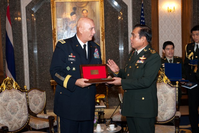 Chief of Staff of the Army Gen. Raymond T. Odierno exchanges gifts with Thai Army Chief of Staff Lt. Gen. Prayut Chan-O-Cha during Odierno's visit to Bangkok, Thailand, July 20, 2012.