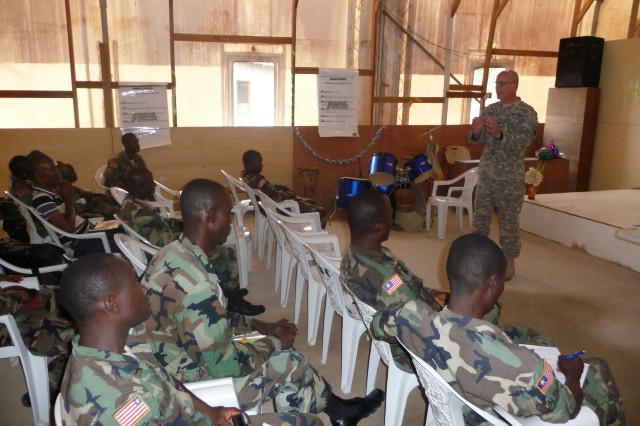 U.S. Army Africa Chaplain (Col.) Jonathan McGraw discusses combat stress control with Armed Forces of Liberia Chaplains. The combat stress symposium, which is very timely since the AFL have recently initiated their first deployment of troops, helped the soldiers learn to deal with the effects of combat and allowed the USARAF chaplains continue to build their relationship with Liberia.