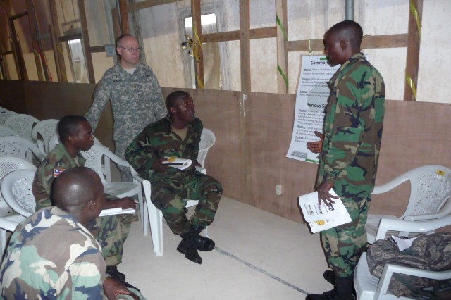 U.S. Army Africa Chaplain (Maj.) Allen Staley coaches Armed Forces of Liberia chaplains and chaplain assistants in a small group learning exercise. The combat stress symposium, which is very timely since the AFL have recently initiated their first deployment of troops, helped the soldiers learn to deal with the effects of combat and allowed the USARAF chaplains continue to build their relationship with Liberia.