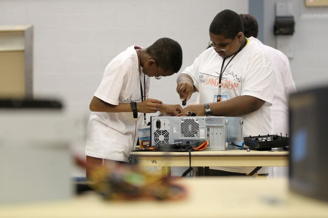 Zalika Hyde, 11, and Tyrek Scott, 12, assemble a desktop computer Monday afternoon at the Geek Squad Summer Technology Academy held at the Youth Services building. Nearly 120 youngsters from the community participated in the two-day program.
