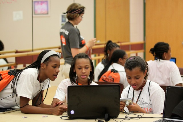 Kayla Hall, 12, Makayla Cropper, 12, and Mina Gaston, 11, work on their digital photography project during the two-day technology camp sponsored by Child, Youth and School Services and the Army Community Service Employment Readiness Program.