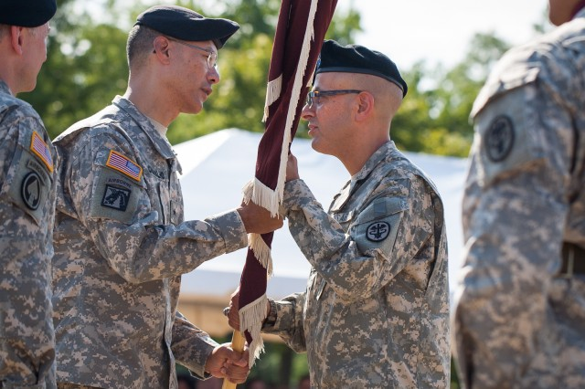 Brig. Gen. (P) Joseph Caravalho Jr., commanding general of the U.S. Army Medical Command's Northern Regional Medical Command, passes the guidon to Col. Danny B.N. Jaghab, incoming commander of U.S. Army Medical Activity, Fort Meade, and Kimbrough Ambulatory Care Center.