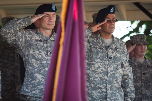 Col. Leon E. Moores, outgoing commander of U.S. Army Medical Activity, Fort Meade, and Kimbrough Ambulatory Care Center, and incoming Commander Col. Danny B.N. Jaghab salute before their change of command ceremony on July 12 at McGlachlin Parade Field.