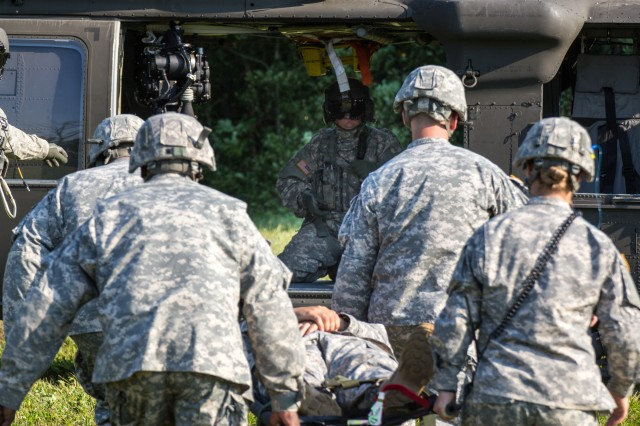 Soldiers of the 401st Civil Affairs Battalion, U.S. Army Reserve, prepare a patient to be loaded onto a Black Hawk from Company F, 1-169th General Support Aviation Battalion of the New York Army National Guard during medical evacuation training at Marcy, N.Y., July 12, 2012.