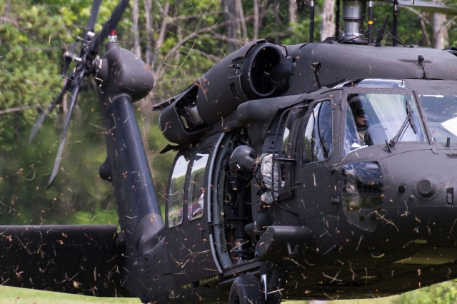 A medevac UH-60 Black Hawk from Company F, 1-169th General Support Aviation Battalion, arrives on site during a medical evacuation exercise conducted near Marcy, N.Y., with the 401st Civil Affairs Battalion of the United States Army Reserve and local volunteer fire fighters, July 12, 2012.