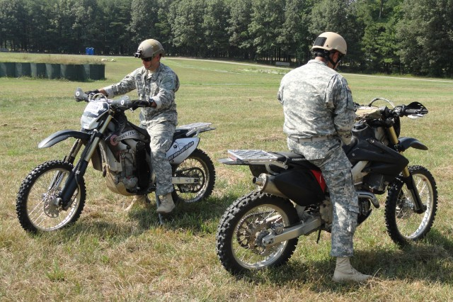 "Mounted on Christini two-wheel drive bikes, members of the quick reaction force prepare to respond to red team live fire during a vignette to test a suite of systems supporting small combat outposts and forward operating bases at the Integrated Base Defense "" Austere exercise at Fort A.P. Hill on July 17, 2012.  The IBD-A exercise was an amalgamation of efforts from multiple military partners, including the Rapid Equipping Force, Joint Program Manager Guardian, and Asymmetric Warfare Group."