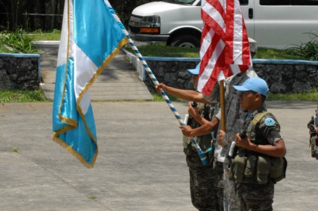 U.S. Army Soldiers and Guatemla Soldiers present colors during the Beyond the Horizon 2012 closing ceremony held at the Regional Training Command for Peacekeeping Operations (CREOMPAZ) held June 27, in Coban, Guatemala. BTH 2012 is a U.S. Army South exercise deploying military engineers and medical professionals to Guatemala for training, while providing services to rural communities