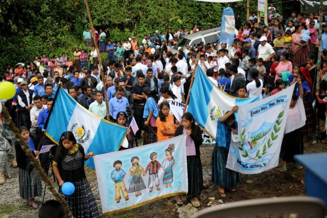 Local Guatemalan citizens wait for the start of the El Rancho medical clinic ribbon-cutting ceremony June 26 near Coban, Guatemala. Construction of the clinic was part of Beyond the Horizon 2012 Guatemala, a U.S. Army South exercise deploying military engineers and medical professionals to Guatemala for training, while providing services to rural communities.