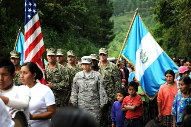 U.S. Army and Navy engineers join Guatemalan citizens in preparation for the El Rancho medical clinic ribbon-cutting ceremony June 26 near Coban, Guatemala. Construction of the clinic was part of Beyond the Horizon 2012 Guatemala, a U.S. Army South exercise deploying military engineers and medical professionals to Guatemala for training, while providing services to rural communities.