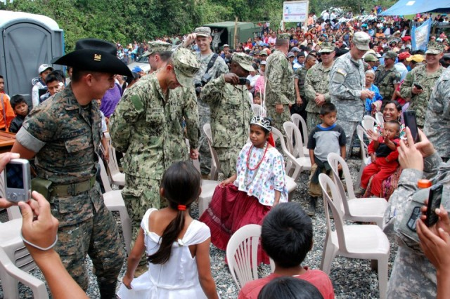 U.S. Army and Navy engineers dance along with Guatemalan army engineers and local children during a ribbon-cutting ceremony at the El Rancho medical clinic near Coban, Guatemala on June 26. Construction of the clinic was part of Beyond the Horizon 2012 Guatemala, a U.S. Army South exercise deploying military engineers and medical professionals to Guatemala.