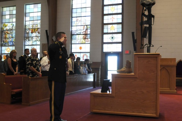 A Soldier salutes 2nd Lt. Christina Cornejo's memorial during a service to honor her life and service July 18. Corenjo passed away July 13. She was with the 100th Missile Defense Brigade, Colorado Army National Guard.