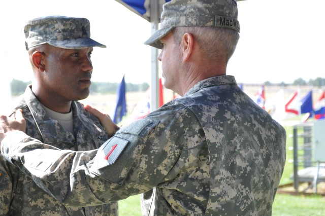 "FORT LEONARD WOOD, Mo. "" Brig. Gen. Donald MacWillie, 1st Infantry Division senior commander, takes a moment to personally thank Command Sgt. Maj. William K. Allen, command sergeant major, 4th Maneuver Enhancement Brigade, 1ID, for his 27 years of military service.  Directly after presenting Allen with a Legion of Merit award, MacWillie oversaw the brigade's change of command and responsibility ceremonies in which Allen relinquishes his responsibility to Command Sgt. Maj. Federico Boyce, and the commander, 4th MEB, 1ID, Col. Frank Y. Rangel, Jr., does the same with his command to Col. James F. Reckard III, Wednesday, July 18. (Photo by U.S. Army Sgt. Kelly S. Malone)"