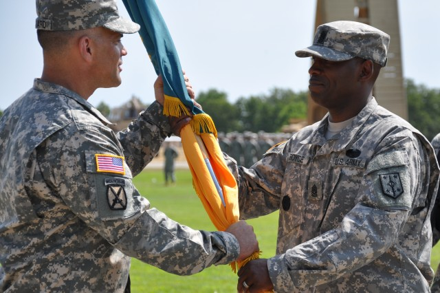 "FORT LEONARD WOOD, Mo. "" Col. James F. Reckard III, commander, 4th Maneuver Enhancement Brigade, 1st Infantry Division, took command from Col. Frank Y. Rangel, Jr., moments ago during the passing of the colors portion of the 4th MEB change of command ceremony held at Gammon Field here, July 18.  The final part of the ceremony is for all the units within the 4th MEB conduct a pass and review for the new commander, where all of the Soldiers march past their commander for his inspection.  (Photo by U.S. Army Sgt. Kelly S. Malone)"