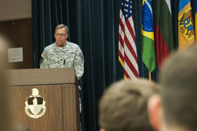 Lt. Col. Brinton H. Rosenberry, commander of 5th Battalion, 1st Special Warfare Training Group (Airborne), speaks during a Psychological Operations Qualification Course graduation ceremony July 20 on Fort Bragg, N.C. Rosenberry's battalion, part of the U.S. Army John F. Kennedy Special Warfare Center and School, conducts all Army military information support operations training. (U.S. Army photo by Dave Chace, SWCS Public Affairs Office)