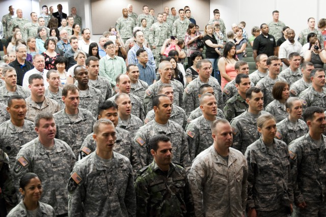 Psychological Operations Qualification Course graduates sing the Army Song at the conclusion of their graduation ceremony July 20 at Fort Bragg, N.C. (U.S. Army photo by Dave Chace, SWCS Public Affairs Office)