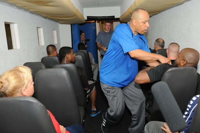 "James Breaux, a personnel recovery agent for U.S. Army South airline passenger and Sgt. First Class Kim Lofton, a chaplain assistant in a simulated hijacking during a three-day captivity avoidance course at the STW Krav Maga gym in San Antonio July 16-18. Krav Maga, a Hebrew word meaning ""contact combat"", is a non-competitive defensive tactic system which teaches students how to defend against attacks from behind, while blindfolded and in confined spaces."