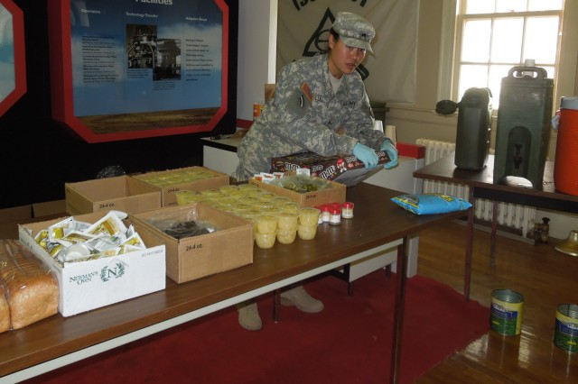 A Reserve Soldier sets up fruit cups and candy for dessert during Operation Golden Cargo at Hawthorne Army Depot, Nev.