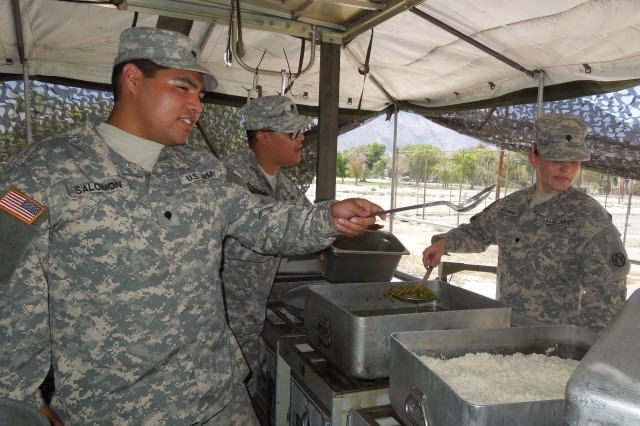 Army Reserve cooks prepare dinner in a Mobile Kitchen Trailer during Operation Golden Cargo at Hawthorne Army Depot, Nev.