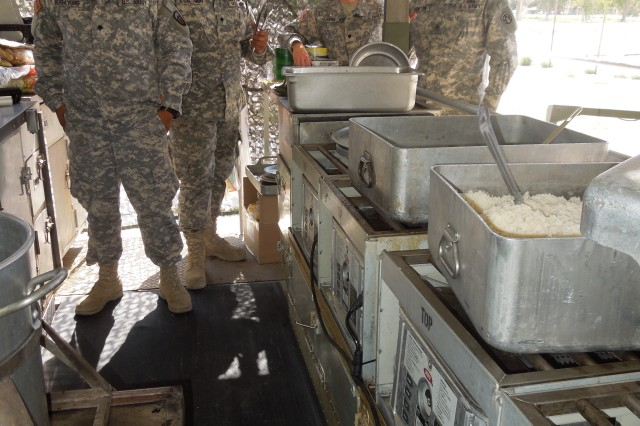Staff Sgt. Andrew Johnston, right, with several of his staff of cooks as they prepare dinner for more than 300 Soldiers at Hawthorne Army Depot, Nev., during Operation Golden Cargo.