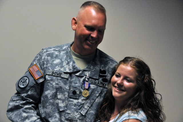 Lt. Col. Jimmy Bowie, assigned to the chief of staff office at AMC, was honored among his friends, family and peers with the Soldier's Medal for his actions following the April 27, 2011 tornados. Melissa Wheeler of Toney, Ala., was trapped in her vehicle and was rescued by Bowie. U.S. Army Photo by Cherish Washington, AMC Public Affairs.