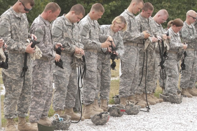 Medics from the 4224th U.S. Army Hospital and Soldiers of the 209th Quartermaster Company go step by step preparing their Swiss seats for rappelling training at Fort Leonard Wood, Mo., during Operation Golden Cargo July 15, 2012.